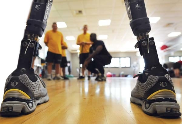 View of the prosthetic legs with people cheering in front