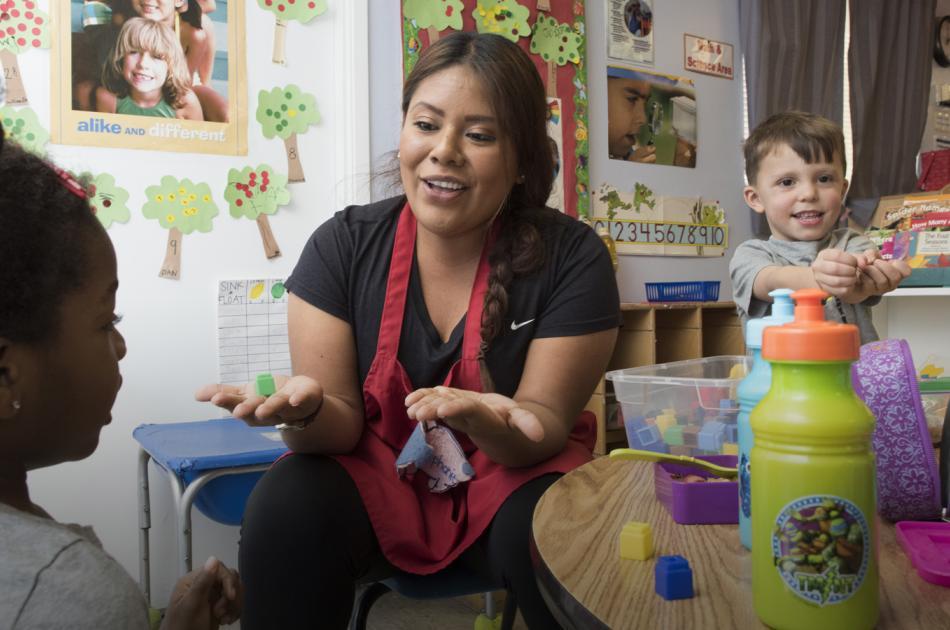 CSUN teacher playing with 2 pre-school children in class