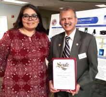 Dean S.K. Ramesh with an Environmental Sustainability Award.
