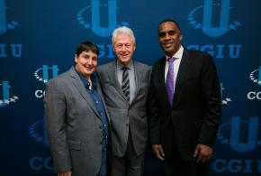 Professor Mary-Pat Stein with President Bill Clinton and another CGI-U guest standing in front of the CGI-U sign.
