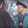 CSUN President Harrison shake hands with grads